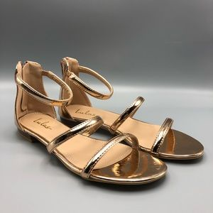 Rose gold flat sandals with straps